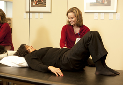 patient with lower back pain at a physical therapy session to minimize chance of spine surgery