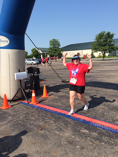 Peggy running a 5K after spine surgery