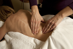 Patient with back pain receiving a lower back pain treatment